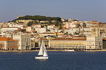 View from River Tagus, showing Praca Comercio, with demonstration, castle and cathedral, Lisbon, Portugal, Europe