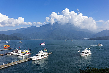 travel destination, photography, horizontal, colour image, horizontal, outdoors, day, cloudy sky, lake, shuishe pier, sun moon lake, taiwan, asia, pier, mountain, blue, elevated view, incidental people, transportation, yacht, taiwanese culture