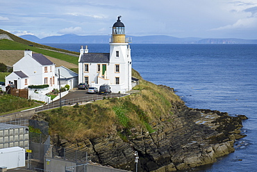 Holborn Head Lighthouse, Scrabster and view of distant Orkney Isles, Caithness, Scotland, United Kingdom, Europe