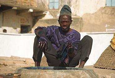 Man working at Kofar Mata dyeing pits, Kano, Nigeria, West Africa, Africa