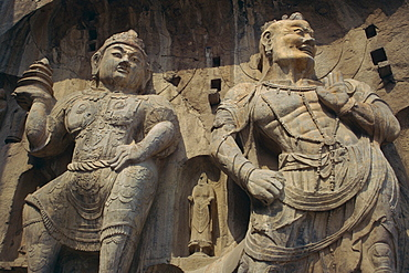 Statues carved in the rock at the Longmen Buddhist caves at Luoyang, UNESCO World Heritage Site, Hunan Province, China, Asia