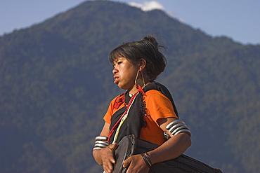 Naga lady dancing and playing, Naga New Year Festival, drum, Lahe village, Sagaing Division, Myanmar (Burma), Asia