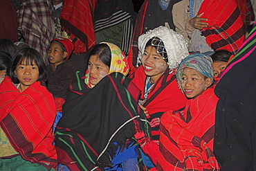 Naga people wrapped up in traditional blankets watching the Grand Finale - tribal dancing round a bonfire, Naga New Year Festival, Lahe village, Sagaing Division,  Myanmar (Burma), Asia