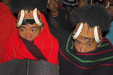 Naga men at Grand Finale (tribal dancing) wrapped up in traditional blankets wearing headdresses of woven cane with wild boars teeth and bear fur, Naga New Year Festival, Lahe village, Sagaing Division, Myanmar (Burma), Asia