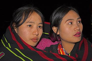 Naga ladies at Grand Finale (tribal dancing) wrapped up in traditional blankets, Naga New Year Festival, Lahe village, Sagaing Division, Myanmar (Burma), Asia
