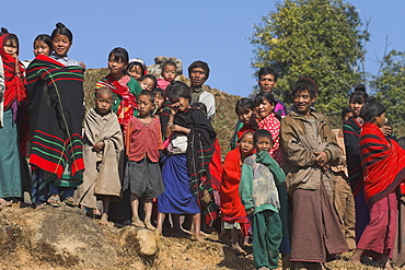 The Naga (Macham tribe) villagers looking at tourists seldom seen in the area, Magyan Village, Sagaing Division,  Myanmar (Burma), Asia