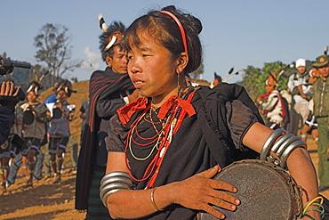 Naga lady dancing and playing drum, Naga New Year Festival, Sagaing Division, Lahe village, Myanmar (Burma), Asia