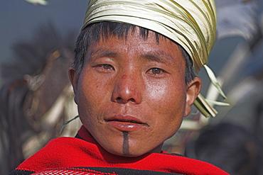 Naga man wearing traditional hand-woven blanket, Naga New Year Festival, Lahe village, Sagaing Division  Myanmar (Burma), Asia