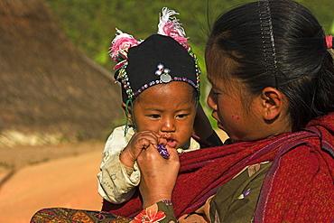 Ann village, Ann girl and baby, Kengtung (Kyaing Tong), Shan State, Myanmar (Burma), Asia