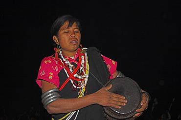 Naga lady dancing and playing drum, Naga New Year festival, Lahe village, Sagaing Division, Myanmar (Burma), Asia