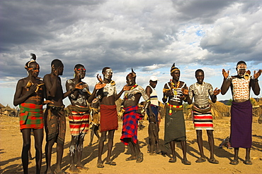 Karo people with body painting, made from mixing animal pigments with clay, dancing, Kolcho village, Lower Omo valley, Ethiopia, Africa