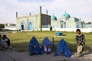 Street boy who sells necklaces for living and ladies in burquas, Shrine of Hazrat Ali, Mazar-I-Sharif, Afghanistan, Asia