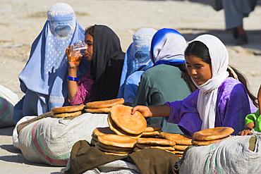 Girls selling bread on the street, Mazar-I-Sharif, Afghanistan, Asia