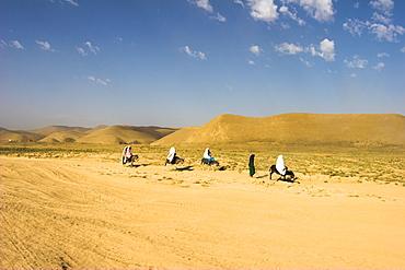Women ride donkeys along side of road between Maimana and Mazar-I-Sharif, Afghanistan, Asia