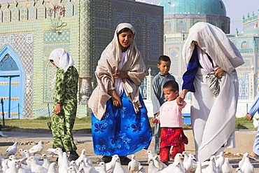 Family looking at the famous white pigeons, Shrine of Hazrat Ali, Mazar-I-Sharif, Afghanistan, Asia