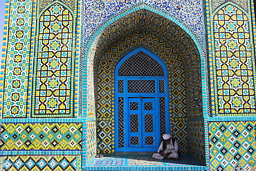 Pilgrim sits in a niche at the Shrine of Hazrat Ali, who was assassinated in 661, Mazar-I-Sharif, Afghanistan, Asia