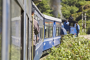 Steam train known as the Toy Train of the Darjeeling Himalayan Railway, UNESCO World Heritage Site, en route from Darjeeling to Ghoom, Darjeeling, West Bengal, India, Asia