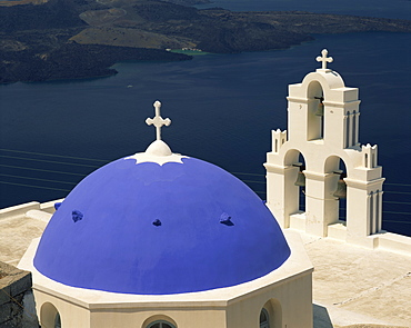 Close-up of the blue dome and bell tower of the Agiou Mina Church, high above the sea at Firostephani near Fira Town, Santorini (Thira), Cyclades Islands, Greek Islands, Europe