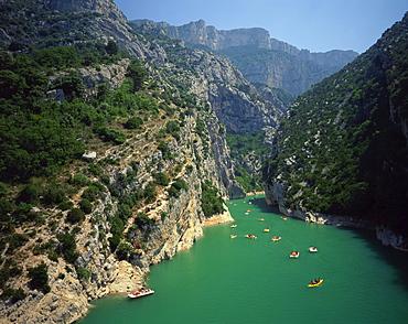 Canoes and pedalos on the River Verdon in the Grand Canyon du Verdon near Lac de Ste Croix, in the Alpes de Haute Provence, Provence, France, Europe