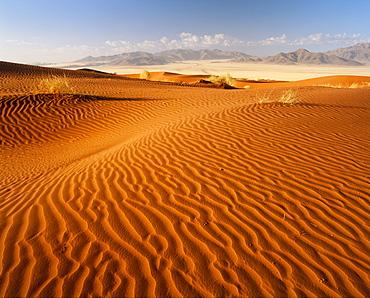 Sand dunes and mountains, Namib Rand game reserve, Namib Naukluft Park, Namibia, Africa