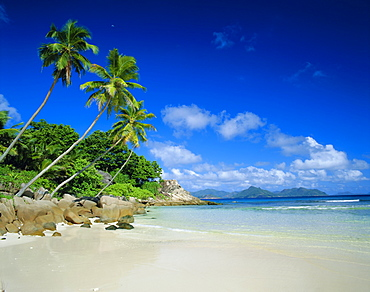 Anse Severe, La Digue, Praslin Island in background, Seychelles