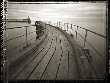 Pinhole camera image of view along timber walkway of Blyth Pier towards lighthouse, Blyth, Northumberland, England, United Kingdom, Europe