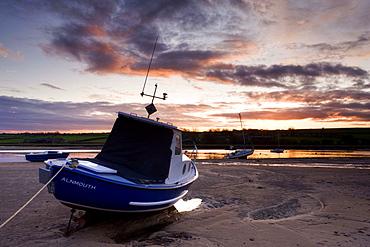 Fishing boat on the Aln Estuary at sunset, Alnmouth, near Alnwick, Northumberland, England, United Kingdom, Europe