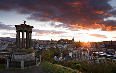 View over Edinburgh from Calton Hill at sunset with the Dugald Stewart Monument in the foreground, Edinburgh, Lothian, Scotland, United Kingdom, Europe