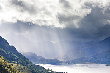 View from Carr Brae towards head of Loch Duich and Five Sisters of Kintail with rays of sunlight bursting through sky, Highlands, Scotland, United Kingdom, Europe