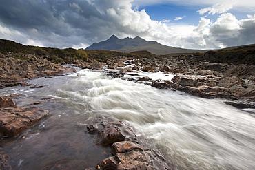 River Sligachan tumbling over rocks with Sgurr nan Gillean in distance, Glen Sligachan, Isle of Skye, Highlands, Scotland, United Kingdom, Europe
