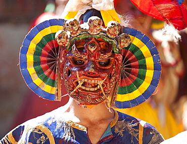 Buddhist monk wearing colourful carved wooden mask at the Tamshing Phala Choepa Tsechu, near Jakar, Bumthang, Bhutan, Asia