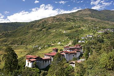 Trongsa Dzong set among tree-covered hills near the town of Trongsa, Bhutan, Asia