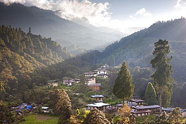 Village of Chendebji set among forested hills between the towns of Wangdue Phodrang and Trongsa, Bhutan, Himalayas, Asia