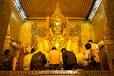 Myanmar's most famous Buddha image, 13ft high and covered in 6 inches of pure gold leaf , Mahamuni Paya, Mandalay, Myanmar (Burma), Southeast Asia