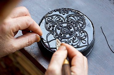 Black Kengtung style lacquerware being made at U Mu Ling Ta, a fifth-generation shop specialising in lacquerware in Kengtung (Kyaingtong), Shan State, Myanmar (Burma), Asia