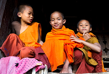 Three novice monks in village near Kengtung (Kyaingtong), Shan State, Myanmar (Burma), Asia