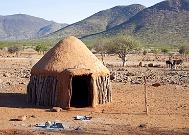 Traditional mud-covered dwelling in a Himba village in the Kunene Region, formerly Kaokoland, in the far north of Namibia, Africa