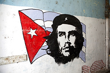 Mural of Che Guevara and the Cuba, West Indies, Central American flag painted on a wall, Havana, Cuba, West Indies, Central America