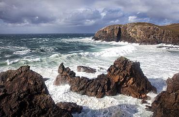 Heavy seas pounding the rocky coastline at Dalbeg, near Carloway, Isle of Lewis, Outer Hebrides, Scotland, United Kingdom, Europe