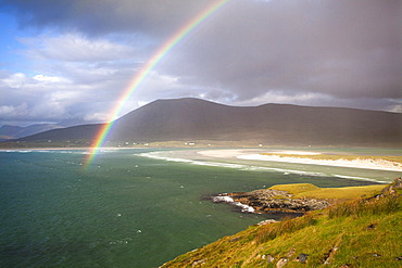 View across the beach at Seilebost towards Luskentyre and the hills of North Harris with a rainbow arching across the scene, Seilebost, Isle of Harris, Outer Hebrides, Scotland, United Kingdom, Europe