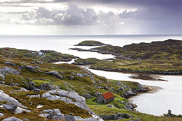View out to sea over abandoned crofts at the township of Manish on the east coast of the Isle of Harris, Outer Hebrides, Scotland, United Kingdom, Europe