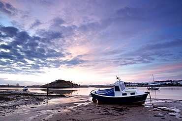 Winter sunrise on the Aln Estuary looking towards Church Hill with boats moored and reflections in the calm water, Alnmouth, near Alnwick, Northumberland, England, United Kingdom, Europe