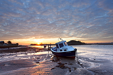 Winter sunrise on the Aln Estuary looking across the sand at low tide to Church Hill, Alnmouth, near Alnwick, Northumberland, England, United Kingdom, Europe