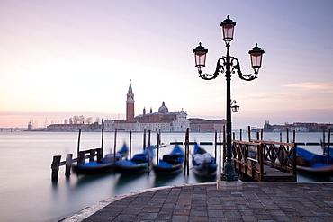 View towards San Giorgio Maggiore at dawn from Riva Degli Schiavoni, with gondolas in foreground, Venice, UNESCO World Heritage Site, Veneto, Italy, Europe