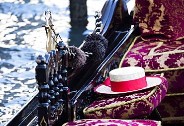 Detail of traditional Venetian Gondola showing Gondolier's straw hat, Venice, Veneto, Italy, Europe