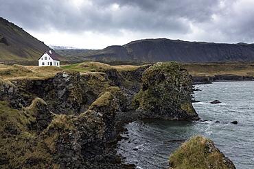 Lone white house among the sea stacks and moutains at Arnastapi, Snaefellsnes Peninsula, Iceland, Polar Regions
