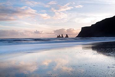 Rock stacks of Reynisfjara, captured from beach at Vik Y Myrdal at sunset, South Iceland, Polar Regions