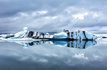 Icebergs and reflections on Jokulsarlon glacial lagoon, South Iceland, Polar Regions