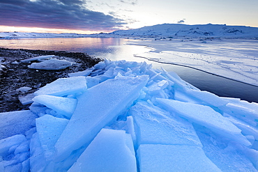 Sunset over frozen Jokulsarlon Glacial Lagoon in winter, South Iceland, Polar Regions