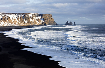 Winter view across the North Atlantic from Dyrholaey towards Reynisdrangar, near Vik, South Iceland, Polar Regions